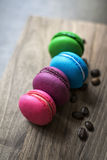 Colorful macaroons on wooden background. Royalty Free Stock Photos