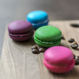 Colorful macaroons on wooden background Stock Photo