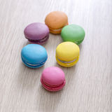 Colorful macaroons on wooden background Royalty Free Stock Photo