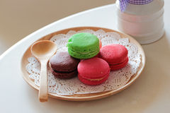 Colorful macaroons. With wooden spoon Stock Image
