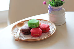 Colorful macaroons. With wooden spoon Royalty Free Stock Photo