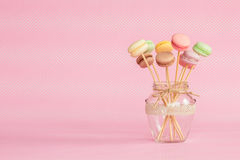 Colorful macaroons on wooden sticks Stock Photography