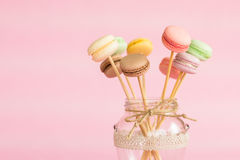 Colorful macaroons on wooden sticks Royalty Free Stock Image