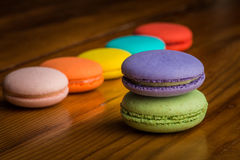 Colorful macaroons on a wooden table Stock Image