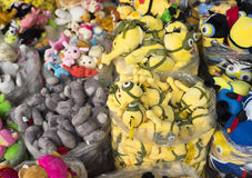 Colorful made in China minions puppets and teddy for sale Royalty Free Stock Photo