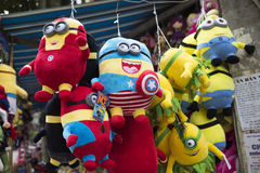 Colorful made in China minions puppets and teddy for sale Stock Image