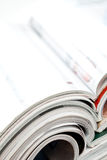 Colorful magazines. Stack of open colorful magazines - close-up Stock Image