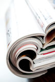 Colorful magazines. Stack of open colorful magazines - close-up Stock Images
