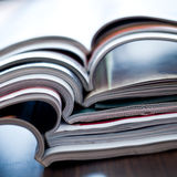 Colorful magazines. Stack of open colorful magazines - close-up Royalty Free Stock Photo