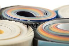 Colorful magazines close up photo. Rolled up composition Royalty Free Stock Image