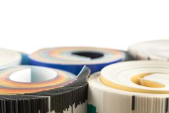 Colorful magazines close up photo. Rolled up composition Royalty Free Stock Photos