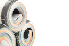 Colorful magazines close up photo. Rolled up composition Stock Photos