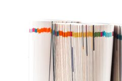 Colorful magazines close up photo. Rolled up composition Stock Photo