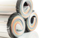 Colorful magazines close up photo. Rolled up composition Royalty Free Stock Photography
