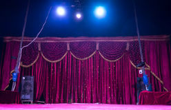 Colorful magenta curtains on a stage with spots Royalty Free Stock Image
