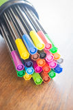 Colorful magic pens on wooden table Stock Photo