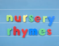 Colorful magnetic letters spelling nursery rhymes. Stock Photography