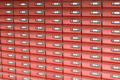 Colorful Mailboxes. Shows a series of mailboxes all of similar colour Royalty Free Stock Photography