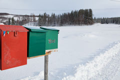 Colorful mailboxes in snow. Norway winter countryside, some mail boxes in snow Stock Photo