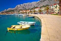 Colorful Makarska boats and waterfront under Biokovo mountain vi Royalty Free Stock Photography