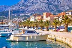 Colorful Makarska boats and waterfront under Biokovo mountain vi Royalty Free Stock Image