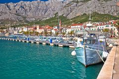 Colorful Makarska boats and waterfront under Biokovo mountain vi Royalty Free Stock Photo