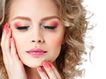 Colorful make up shadows and nails woman beauty portrait isolated on white. Studio shot stock image