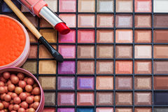 Colorful makeup brushes and makeup eye shadows Stock Image