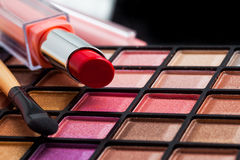 Colorful makeup brushes and makeup eye shadows Royalty Free Stock Photo
