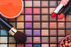 Colorful makeup brushes and makeup eye shadows. Professional makeup palette, makeup brushes and cosmetics Royalty Free Stock Image
