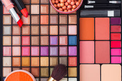 Colorful makeup brushes and makeup eye shadows Royalty Free Stock Photography