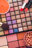 Colorful makeup brushes and makeup eye shadows Stock Photos