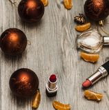 Colorful makeup makeup with a Christmas decoration on a wooden background stock photography