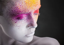 Colorful makeup. Close-up of a young woman with colorful makeup on a black background royalty free stock images
