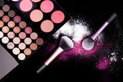 Colorful makeup palette and brush to apply powder. on pure black background. Stock Photography