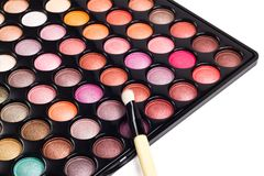Colorful makeup palette with brush on white Royalty Free Stock Photo