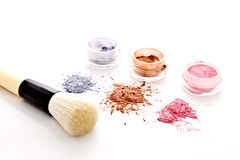 Colorful makeup powder and brush Royalty Free Stock Photos