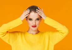 Colorful makeup woman red lips in yellow clothes on color happy summer fashion background manicured nails stock image
