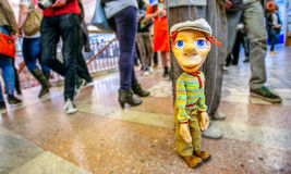 Colorful man marionette at public place Stock Image