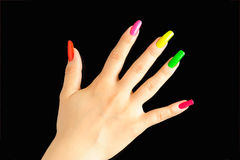 Colorful manicure. On real nails over black background Stock Photography
