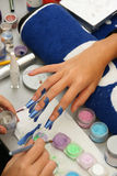 Colorful manicure. Manicure procedure in beauty center Royalty Free Stock Photos