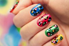 Colorful manicure close up with dots. stock photos