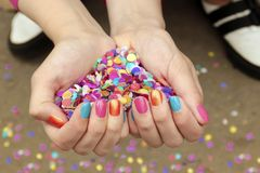 Colorful colorful manicure with confetti royalty free stock image