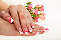 Colorful manicure with points on a lilac Stock Photo