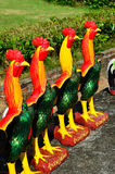 Colorful of a many chicken statues Stock Images