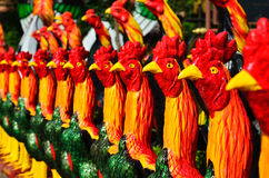 Colorful of a many chicken statues Stock Photo