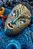 Colorful Maori Carved Face. Bright and colorful maori carving of a face, with lot of detail Stock Image