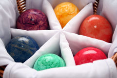 Colorful Marble Eggs. A collection of colorful marble eggs in a divided basket stock photography
