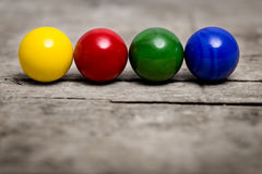 Colorful marbles in a line Royalty Free Stock Photo