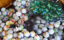 Colorful marbles stacked in a net stock image